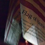 Flags hung from the Dumont fire truck.. PHOTO/Dan O'Leary