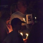 Dumont residents keep loved ones close to their hearts during a candle light vigil. PHOTO by Dan O'Leary
